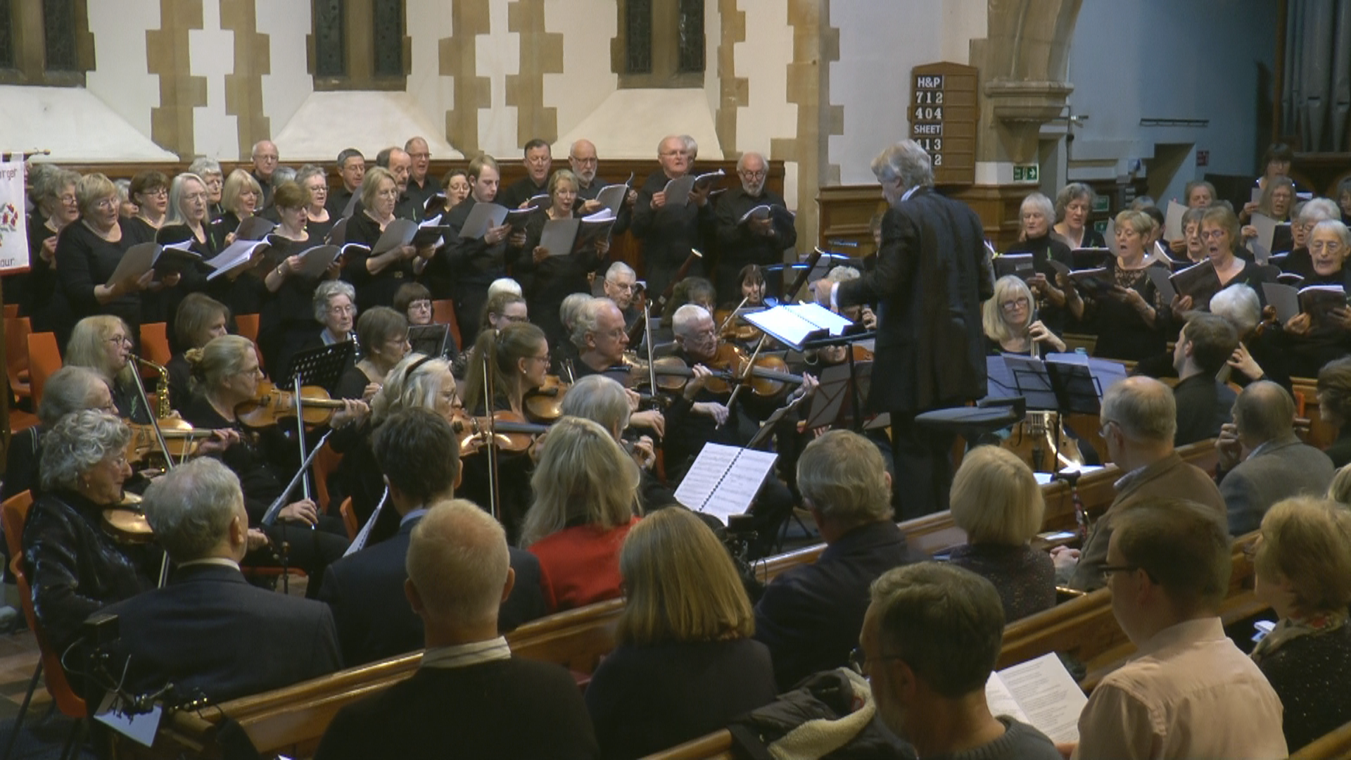 Choir & orchestra with Nigel conducting